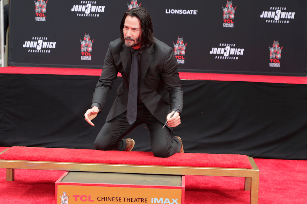 "Keanu Reeves ""Honored"" To Have Hands And Feet Cemented In Hollywood"